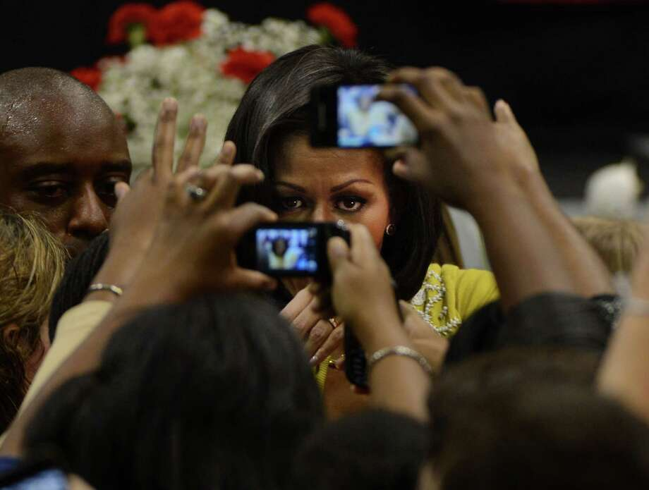 First lady Michelle Obama greets students and supporters for President Barack Obama during a campaign visit to Ohio Wesleyan's Branch Rickey Arena Monday, October 15, 2012, in Delaware, Ohio. (Neal C. Lauron/Columbus Dispatch/MCT) Photo: NEAL C. LAURON, McClatchy-Tribune News Service / Columbus Dispatch