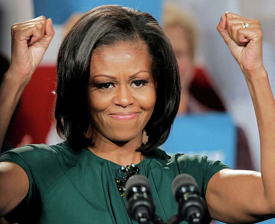 First lady Michelle Obama reacts to the cheers as she campaigns for her husband, President Barack Obama, at a rally at the Douglas County Fairgrounds in Castle Rock, Colo., Thursday, Oct. 11, 2012.  (AP Photo/Ed Andrieski) Photo: Ed Andrieski, Associated Press / AP