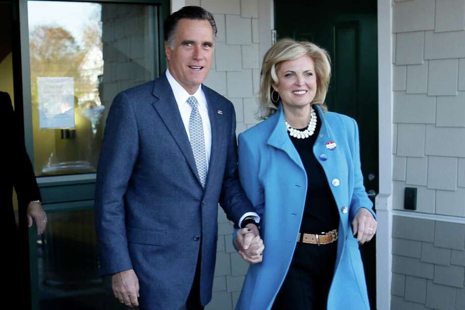 Republican presidential candidate, former Massachusetts Gov. Mitt Romney and his wife Ann Romney emerge after they voted in Belmont, Mass., Tuesday, Nov. 6, 2012. (AP Photo/Charles Dharapak) Photo: Charles Dharapak, Associated Press / AP