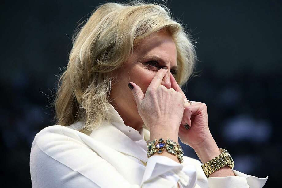 MANCHESTER, NH - NOVEMBER 05:  Ann Romney, wife of Republican presidential candidate, former Massachusetts Gov. Mitt Romney, wipes away tears during the final campaign rally at Verizon Wireless Arena on November 5, 2012 in Manchester, New Hampshire. A day before the election, Romney was making one final push through the swing states. Photo: Justin Sullivan, Getty Images / 2012 Getty Images