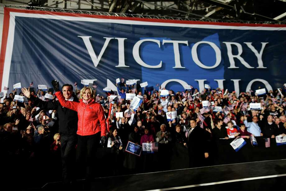 Republican presidential candidate and former Massachusetts Gov. Mitt Romney and Ann Romney arrive at a Ohio campaign rally at Port Columbus International Airport, in Columbus, Ohio, Monday, Nov. 5, 2012. (AP Photo/Charles Dharapak) Photo: Charles Dharapak, Associated Press / AP