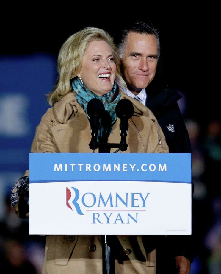 Republican presidential candidate, former Massachusetts Gov. Mitt Romney, right, is joined on stage by his wife Ann as they appear at a campaign event at Shady Brook Farm, Sunday, Nov. 4, 2012, in Morrisville, Penn. (AP Photo/David Goldman) Photo: David Goldman, Associated Press / AP
