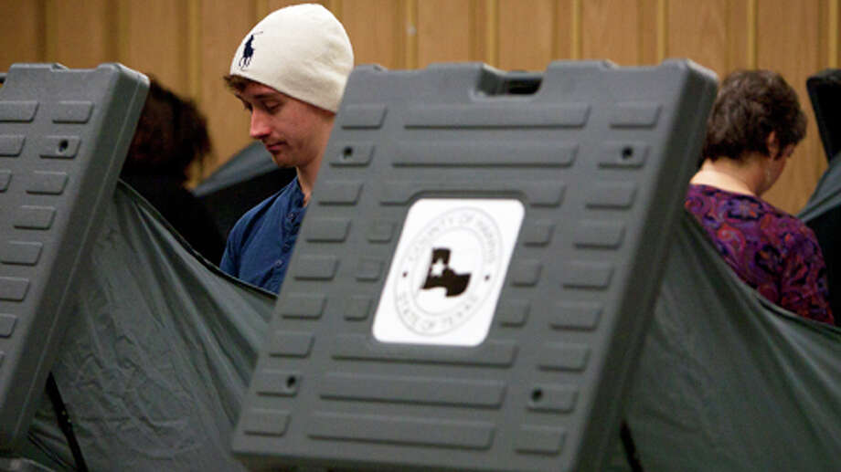 First-time voter Aaron Sharratt, 20,  casts his vote inside the West Gray Recreation Center Tuesday, Nov. 6, 2012, in Houston. Photo: Cody Duty, . / © 2012 Houston Chronicle