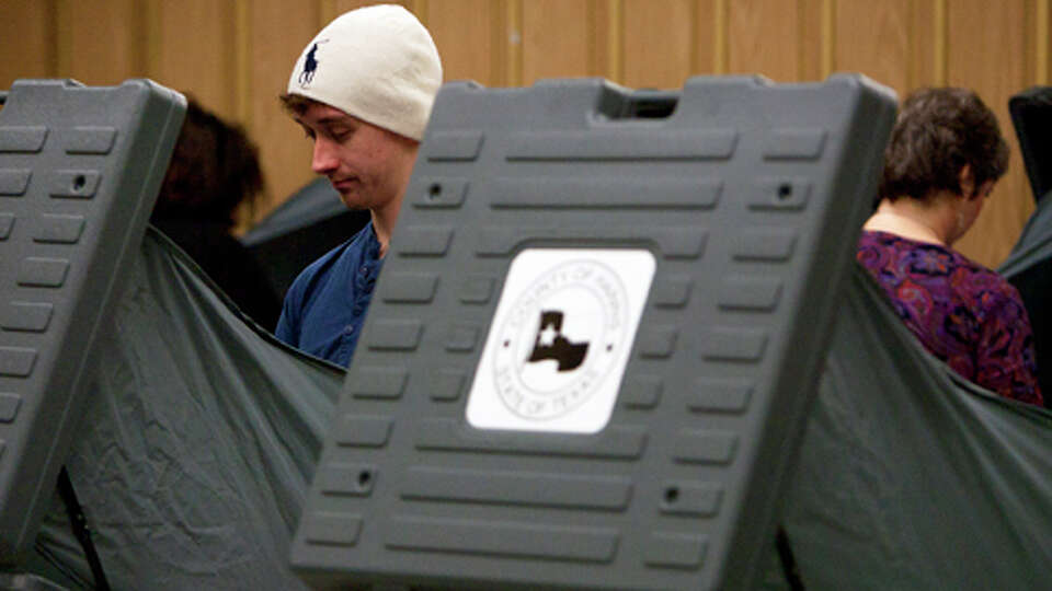 First-time voter Aaron Sharratt, 20,  casts his vote inside the West Gray Recreation Center Tuesday,