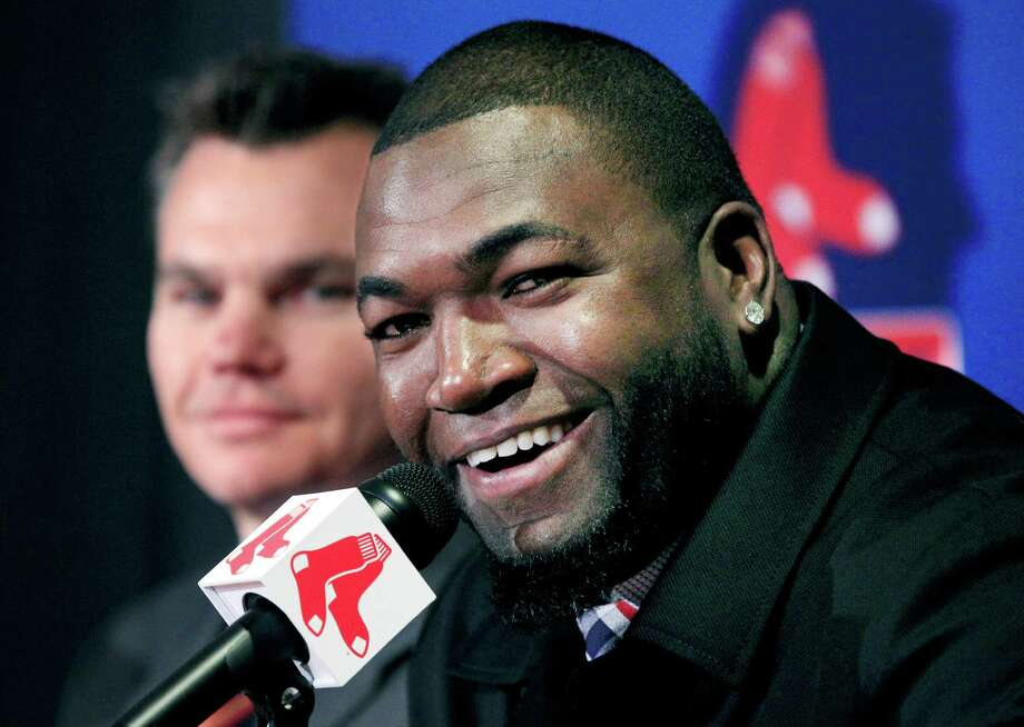 Boston Red Sox's David Ortiz speaks as general manager Ben Cherington, left, listens during a baseball news conference, Monday, Nov. 5, 2012, at Fenway Park in Boston. Ortiz announced that he has finalized a $26 million, two-year contract, which includes bonuses that could raise the value to $30 million. (AP Photo/Elise Amendola) Photo: Elise Amendola