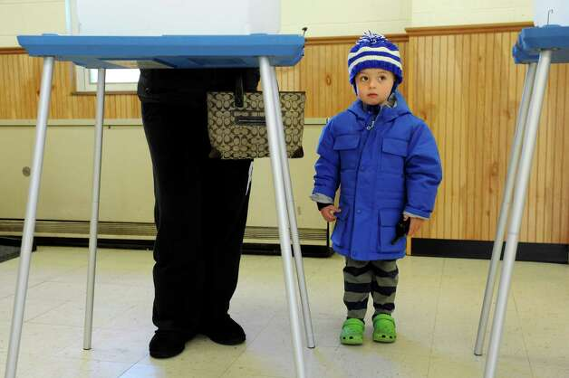 Michael Field, 4, waits for his mother, Ariane, to finish voting Tuesday at Colonie Town Hall in Loudonville. (Cindy Schultz / Times Union) Photo: Cindy Schultz