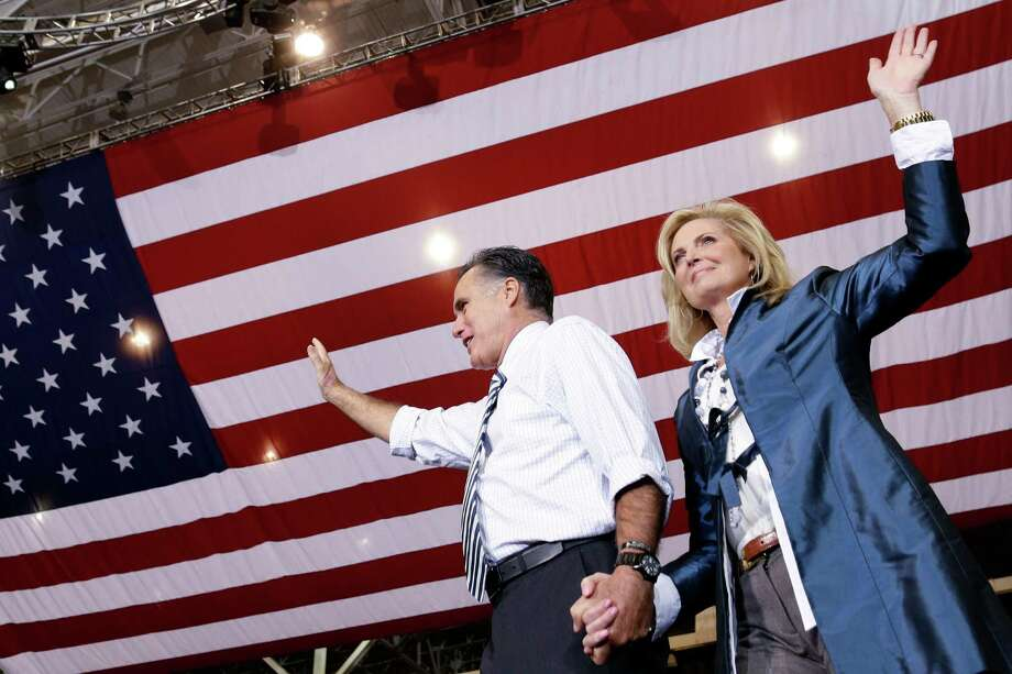 Republican presidential candidate and former Massachusetts Gov. Mitt Romney holds his wife Ann's hand as they arrive to campaign at the International Exposition Center in Cleveland, Sunday, Nov. 4, 2012. (AP Photo/Charles Dharapak) Photo: Charles Dharapak, Associated Press / AP