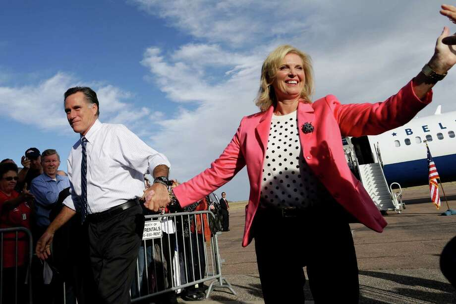Republican presidential candidate and former Massachusetts Gov. Mitt Romney campaigns with wife Ann Romney at Colorado Springs Municipal Airport in Colorado Springs, Col., Saturday, Nov. 3, 2012. (AP Photo/Charles Dharapak) Photo: Charles Dharapak, Associated Press / AP