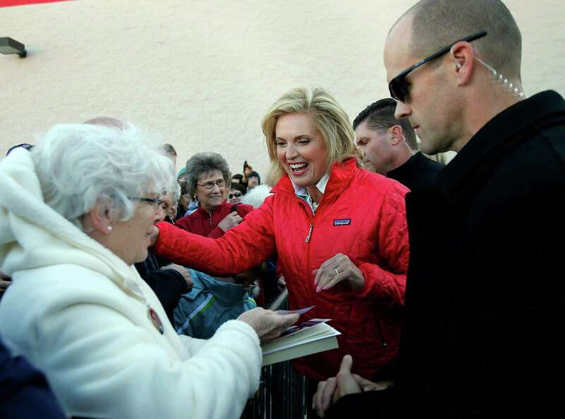 Ann Romney, wife of Republican presidential candidate Mitt Romney, shakes hands with supporters duri