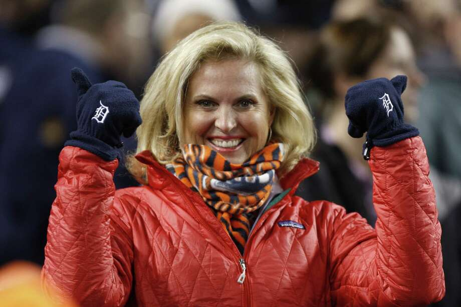 Ann Romney, wife of Republican presidential candiadate Mitt Romney, shows off her Detroit gloves at Game 4 of the 2012 World Series between the Detroit Tigers and the San Francisco Giants at Comerica Park in Detroit, Michigan, Sunday, October 28, 2012. (Kirthmon F. Dozier/Detroit Free Press/MCT) Photo: Kirthmon F. Dozier, McClatchy-Tribune News Service / Detroit Free Press