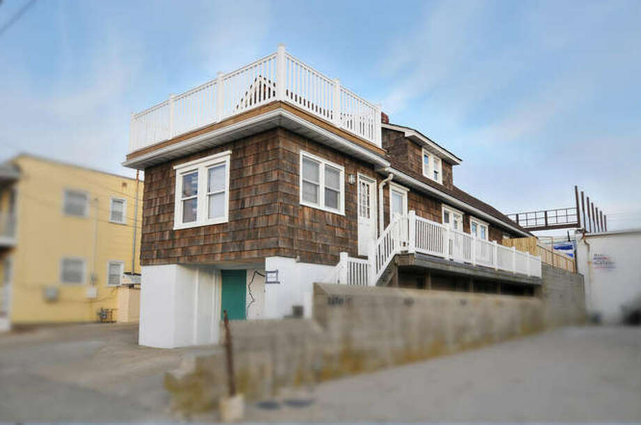 This is a rental listing picture of the house from before Superstorm Sandy. The house looks modest from the outside but between the six bedrooms and the decks it has plenty of space for large groups. (Michael Loundy/Seaside Realty)