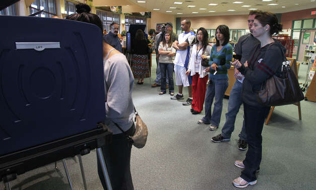 People wait in line and vote on election day Tuesday November 6, 2012 at Longs Creek Elementary School. Polls are open from 7:00 a.m. to 7:00 p.m. on Election Day. Photo: John Davenport/Express-News