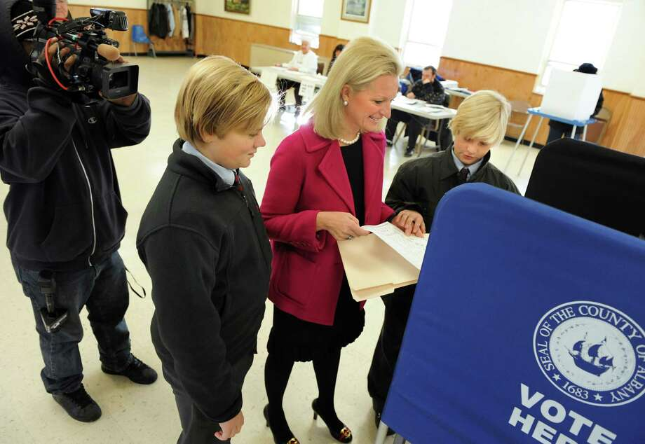 Jennifer Whalen, running for State Assembly, center, votes on Tuesday, Nov. 6, 2012, at Colonie Town Hall in Loudenville, N.Y. Joining her are sons Leland Ben, 13, left, and Reade Ben, 12. (Cindy Schultz / Times Union) Photo: Cindy Schultz, Albany Times Union / 00019952A