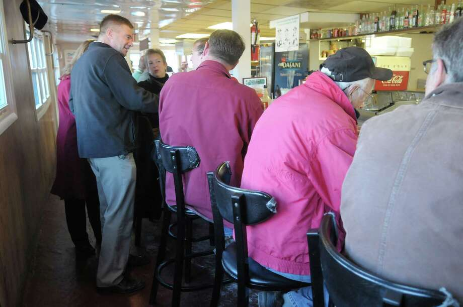 Congressman Chris Gibson, left, talks with customers at Duncan's Dairy Barn on Tuesday morning, Nov. 6, 2012 in Troy, NY.    (Paul Buckowski / Times Union) Photo: Paul Buckowski, Albany Times Union / 00019982A