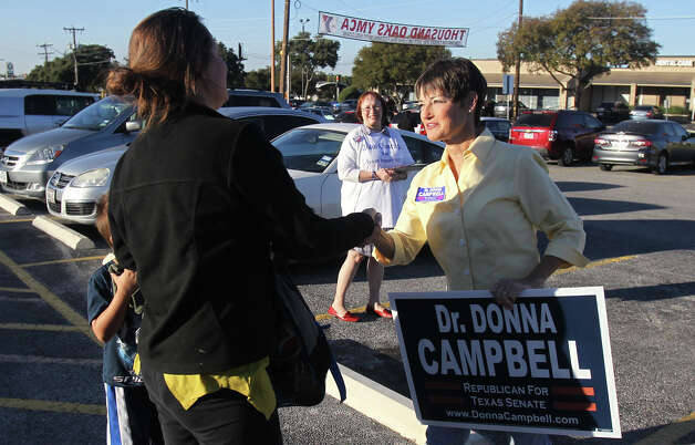 Donna Campbell (right), a Republican candidate for the Texas Senate, solicits voter Kristen Alarcon (left) at Thousand Oaks Elementary School on Election Day Tuesday November 6, 2012. The polls close at 7:00 p.m. . Photo: JOHN DAVENPORT, San Antonio Express-News / ©San Antonio Express-News/Photo Can Be Sold to the Public