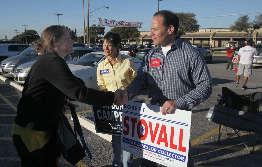 Donna Campbell (center), a Republican candidate for the Texas Senate, and Robert Stovall (right), a candidate for Tax Assessor Collecor, solicit voter Kristen Alarcon (left) at Thousand Oaks Elementary School on Election Day Tuesday November 6, 2012. The polls close at 7:00 p.m. . Photo: JOHN DAVENPORT, San Antonio Express-News / ©San Antonio Express-News/Photo Can Be Sold to the Public