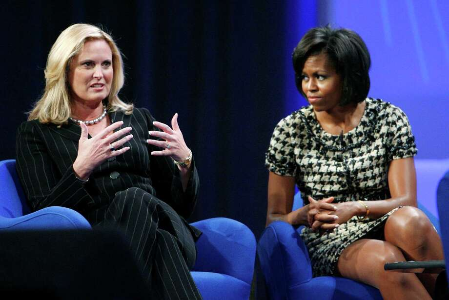 Ann Romney, wife of Republican presidential hopeful Mitt Romney, left, speaks as Michelle Obama, wife of Democratic presidential hopeful Barack Obama, listens at the California Governor and First Lady's Conference on Women in Long Beach, Calif. on Tuesday, Oct. 23, 2007. (AP Photo/Matt Sayles) Photo: Matt Sayles, ASSOCIATED PRESS / R-SAYLES