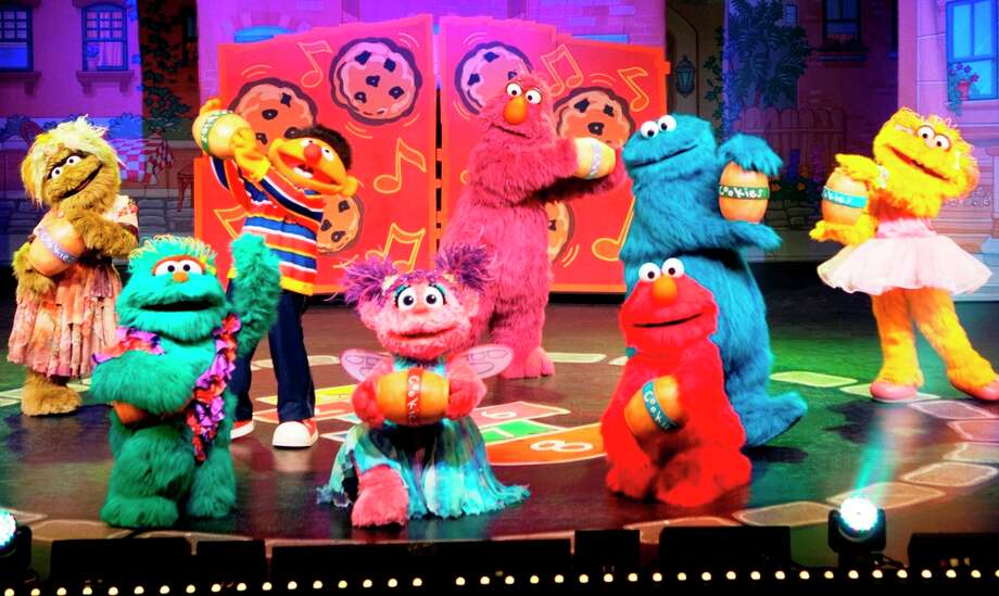 "The ""Sesame Street"" crowd makes music out of cookie jars in ""Sesame Street Live: Elmo Makes Music"" Photo: Courtesy VEE Corp."
