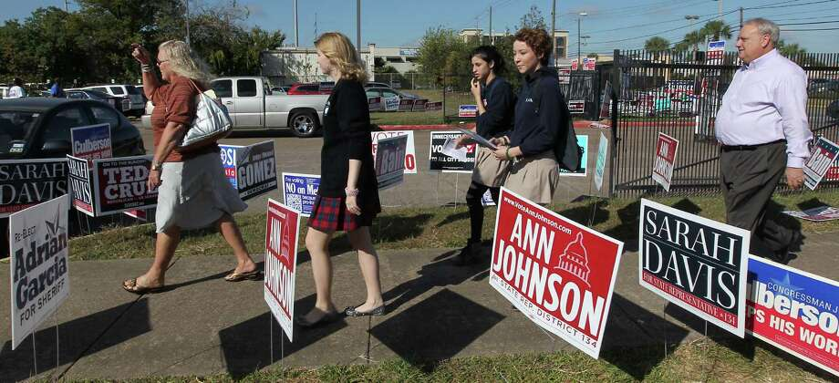 Lamar High School Communication Director Ann Southwell left, along with students Rachel Newsom, Rebecca Altman, Rebecca Milton and Lamar Principal Dr. James McSwain arrive at the Houston Metropolitan Multi-Service Center where the students will cast their votes Thursday, Nov. 1, 2012, in Houston.   