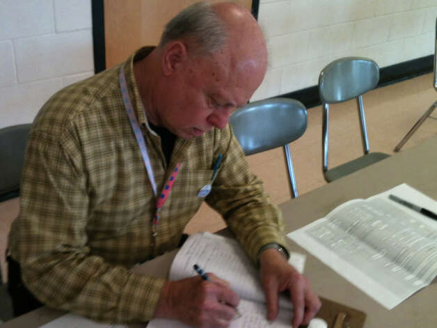 Gary Potmesil, polling station moderator at Fairfield Ludlowe High School, reported heavy turnout at Ludlowe from 6 to 8:30 a.m. Tuesday. Fairfield CT 11/6/12 Photo: Andrew Brophy / Fairfield Citizen contributed