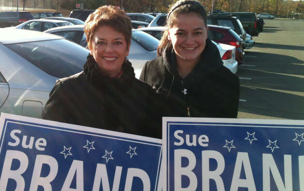 Sue Brand, a Democrat challenging Republican state Rep. Brenda Kupchick, was outside Fairfield Ludlowe High School with her daughter, Elizabeth, on Tuesday morning looking for last-minute support. Fairfield Ct 11/6/12 Photo: Andrew Brophy / Fairfield Citizen contributed