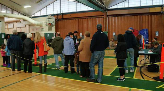 A line of voters waiting to cast ballots early Tuesday at Coleytown Middle School polling station. Westport CT 11/6/12 Photo: Paul Schott / Fairfield Citizen