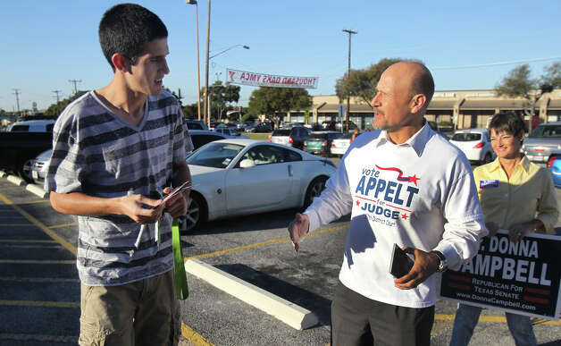 Judicial candidate Joseph Appelt (right, foreground) speaks with voter Brandon Severyn (left) at Thousand Oaks Elemenrary School on Election Day Tuesday November 6, 2012. on the far right (backgrond) is Texas Senate candidate Dr. Donna Campbell. Photo: John Davenport/Express-News