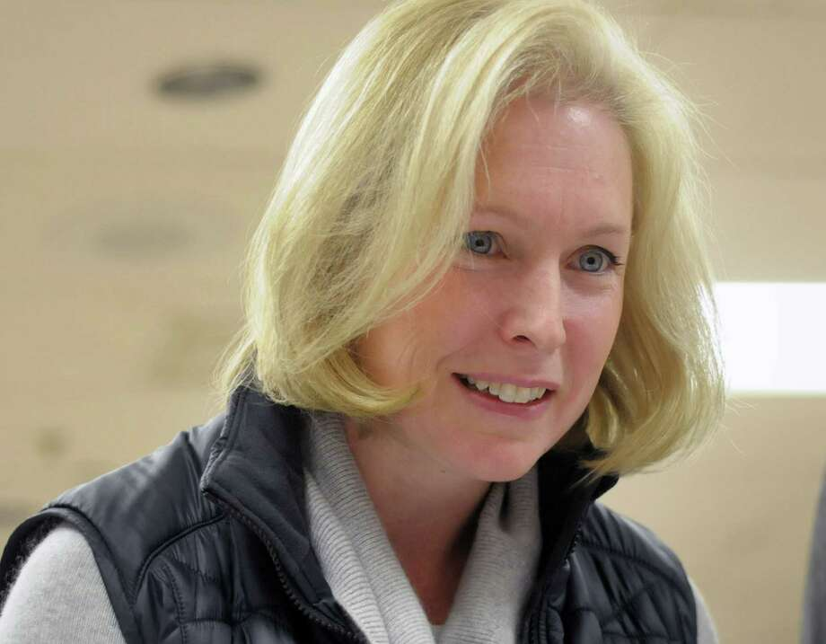 U.S. Senator Kirsten Gillibrand talks with election inspectors as she waited to sing the voting book at the Sycaway Fire House on Tuesday morning, Nov. 6, 2012 in Troy, NY.    (Paul Buckowski / Times Union) Photo: Paul Buckowski, Albany Times Union / 00019996A