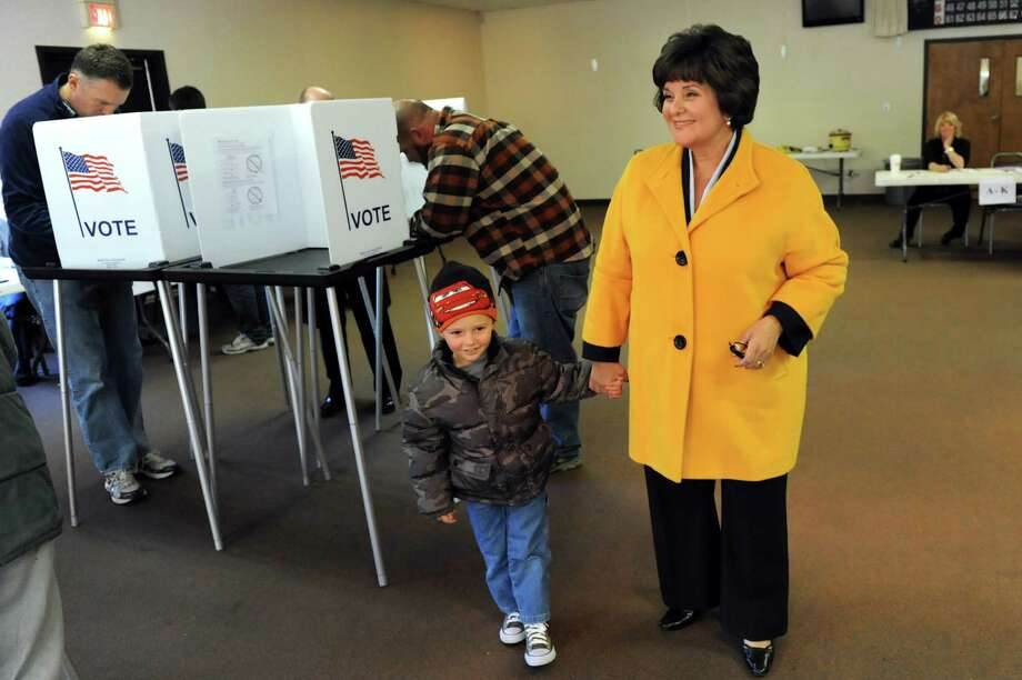 Kathy Marchione, running for the 43rd Senate seat, right, prepares to leave with her grandson Jacob Hickok, 3, after voting on Tuesday, Nov. 6, 2012, at the American Legion Post in Halfmoon, N.Y. (Cindy Schultz / Times Union) Photo: Cindy Schultz, Albany Times Union / 00019991A