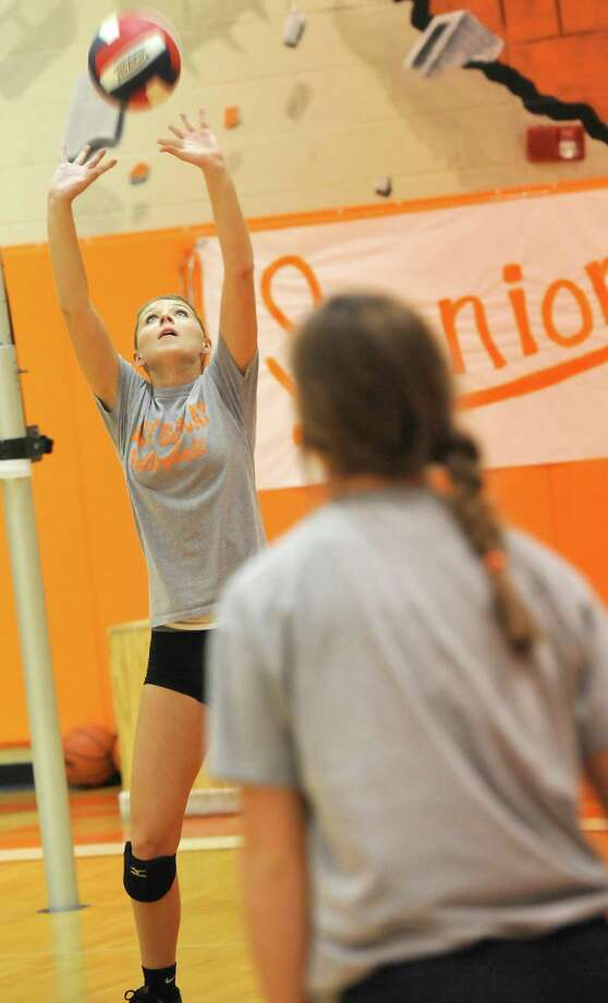 Orangefield's volleyball team has won its first district championship in program history. They are doing it with first-year coach Meagan Adams, who has never coached HS volleyball before. In addition, the team has senior Rylie Granger, left, who missed the first three years of her high school playing career with a foot injury, but now she is back with the team and healthy. Dave Ryan/The Enterprise Photo: Dave Ryan