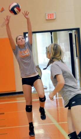Orangefield's volleyball team has won its first district championship in program history. They are doing it with first-year coach Meagan Adams, who has never coached HS volleyball before. In addition, the team has senior Rylie Granger, left, who missed the first three years of her high school playing career with a foot injury, but now she is back with the team and healthy. Dave Ryan/The Enterprise