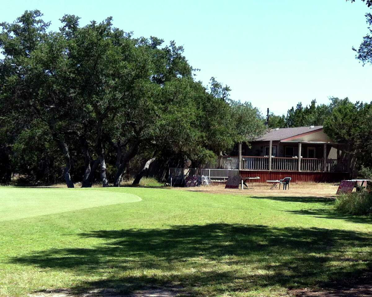 At one of the few houses found along The Hawk at Rebecca Creek, one can stop to buy some balls or even a kid's club or two.