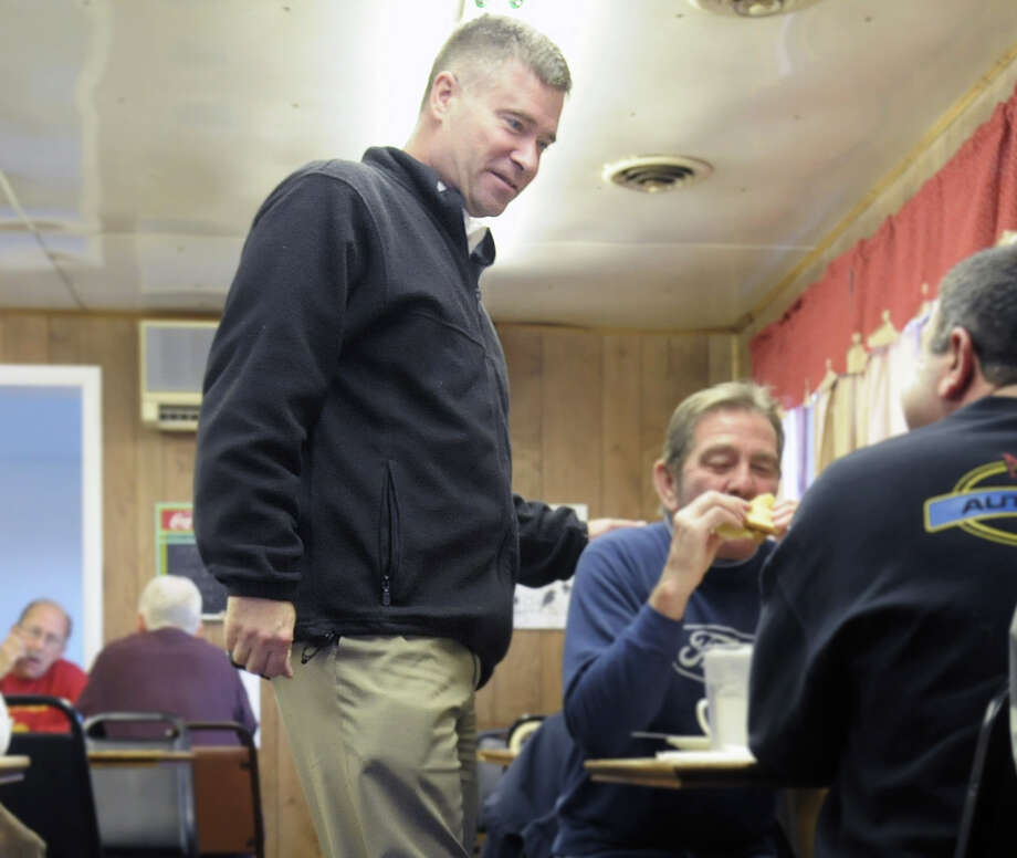 Congressman Chris Gibson talks with customers Tuesday morning at Duncan's Dairy Barn in Troy. (Paul Buckowski / Times Union) Photo: Paul Buckowski  / 00019982A