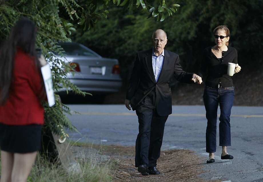 California Gov. Jerry Brown walks with his wife Anne Gust Brown to vote Tuesday, Nov. 6, 2012 at a fire station in Oakland, Calif. Photo: Eric Risberg, Associated Press