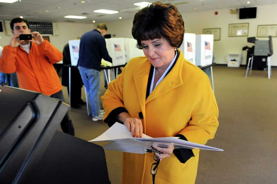 Kathy Marchione, running for a seat in the 43rd Senate District, votes Tuesday morning at the American Legion Post in Halfmoon. (Cindy Schultz / Times Union) Photo: Cindy Schultz / 00019991A