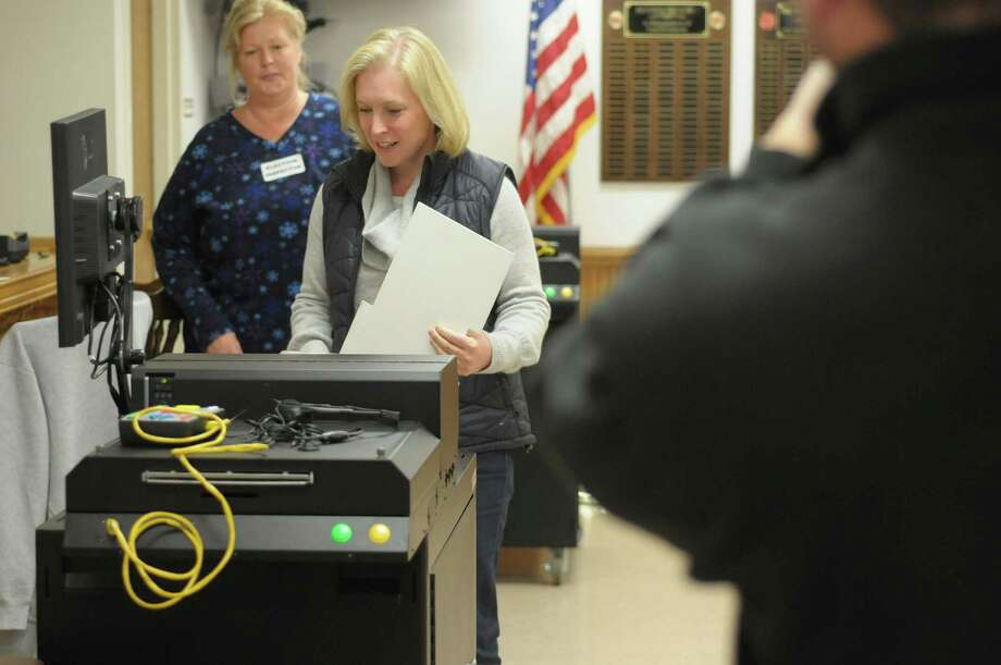 U.S. Sen. Kirsten Gillibrand feeds her ballot into the ballot reading machine Tuesday morning at the Brunswick No. 1 Fire House. (Paul Buckowski / Times Union) Photo: Paul Buckowski / 00019996A