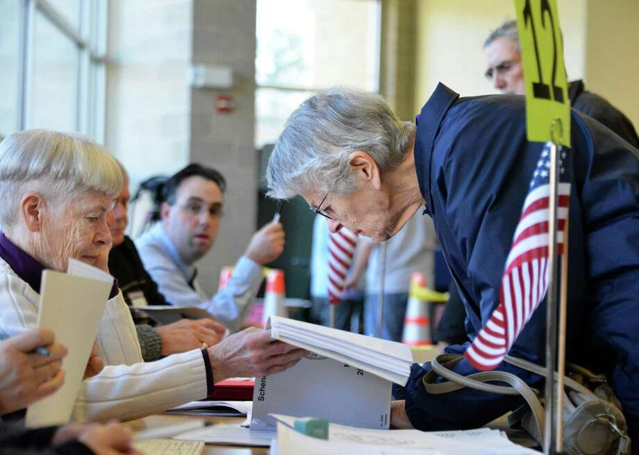 Election inspector Deanna Papasso, left, signs in voter Virginia Csontos on Tuesday at Schalmont High School in Rotterdam. (John Carl D'Annibale / Times Union) Photo: John Carl D'Annibale / 00019998A