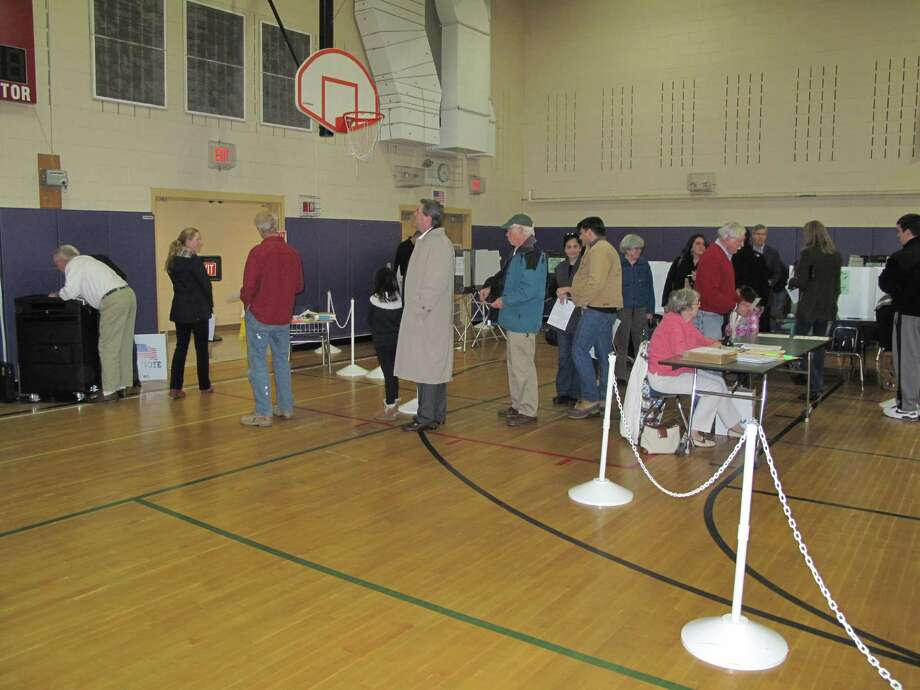 New Canaanites cast their ballots at Saxe Middle School Tuesday morning. Photo: Tyler Woods