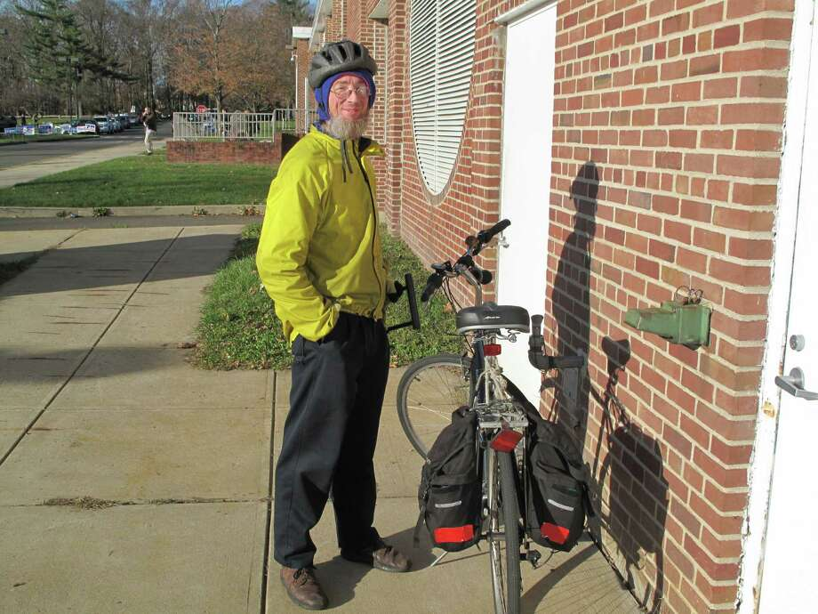 Green party candidate for the 125th State Rep district David Bedell biked to Saxe Middle School Tuesday morning to vote. Photo: Tyler Woods