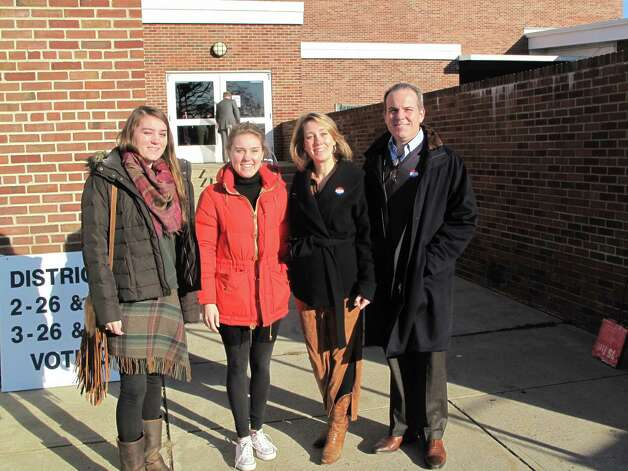 Evelyn, Julia, Jana, and George Harvey outside of Saxe Middle School Tuesday morning. Photo: Tyler Woods