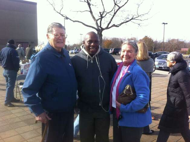 Cy Anfindsen, Peter Aremu, and Maury Anfindsen going to vote at New Canaan High School on Tuesday morning. Photo: Tyler Woods