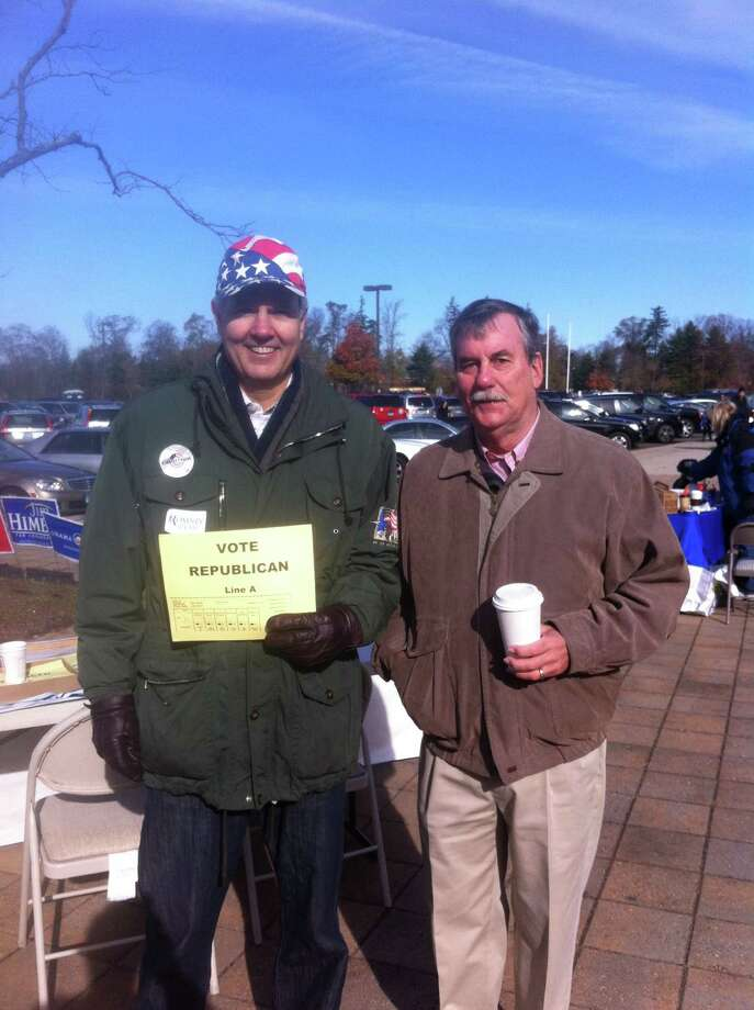 Resident Steve Corkran and Town Councilman Kenneth Campbell work the Republican table outside of New Canaan High School on Tuesday morning. Photo: Tyler Woods