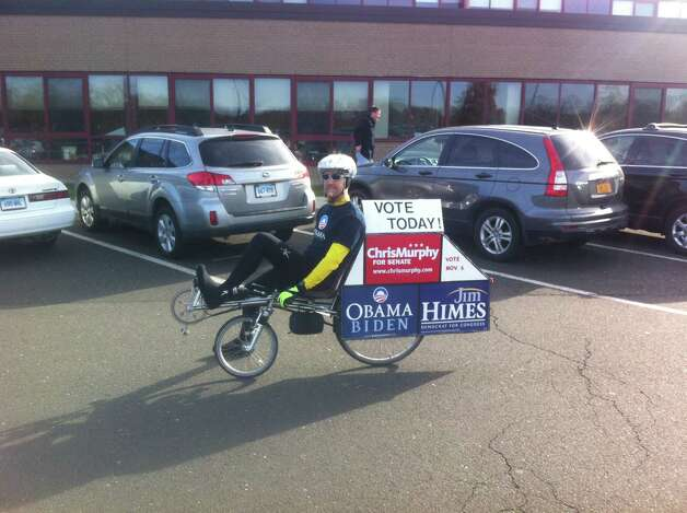 Democratic supporter and bike blogger Mike Norris, of Stamford was out at New Canaan High School on Tuesday morning. Photo: Tyler Woods