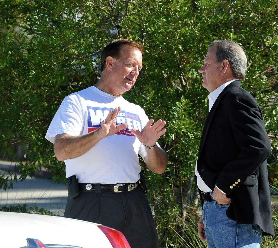 It's Election Day and over at Precinct 65, the Rogers Park Community Center, candidate for judge in the 136th judicial district, Rick Williams, right, meets with Republican candidate for the US Congress Randy Weber, left, before they both moved on to their next appointments.  Dave Ryan/The Enterprise