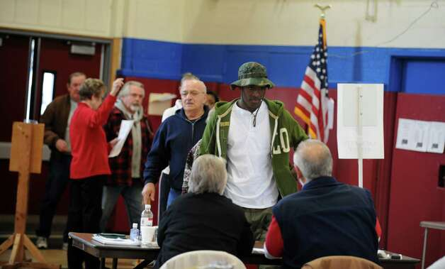 Jocquille Adams votes Tuesday, Nov. 6, 2012 at Irving School in Derby, Conn. Photo: Autumn Driscoll / Connecticut Post