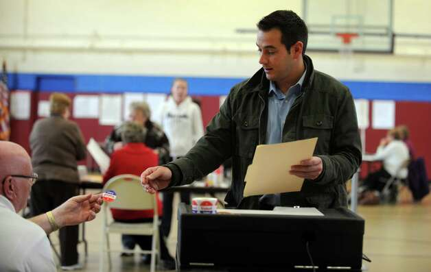 J. R. Romano votes Tuesday, Nov. 6, 2012 at Irving School in Derby, Conn. Photo: Autumn Driscoll / Connecticut Post