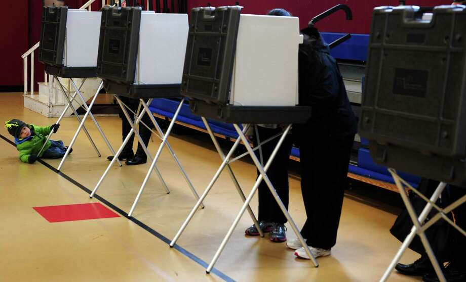 People vote Tuesday, Nov. 6, 2012 at Irving School in Derby, Conn. Photo: Autumn Driscoll / Connecticut Post