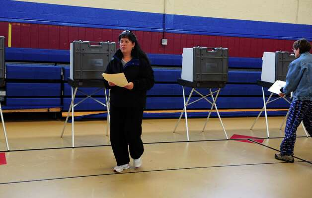 Mary Huie votes Tuesday, Nov. 6, 2012 at Irving School in Derby, Conn. Photo: Autumn Driscoll / Connecticut Post