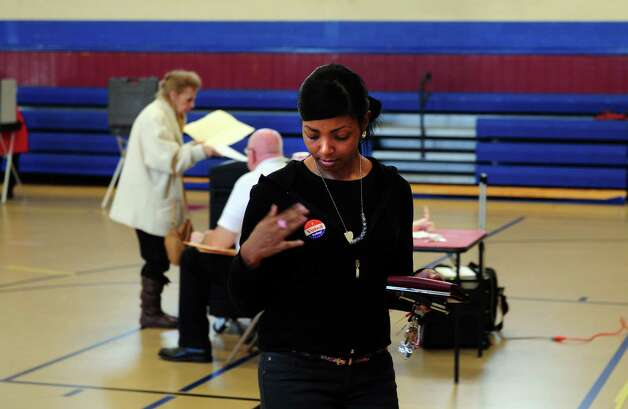 Carnetta Penn votes Tuesday, Nov. 6, 2012 at Irving School in Derby, Conn. Photo: Autumn Driscoll / Connecticut Post