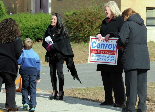 Mary Smith-Porter, of Derby, left, and Theresa Conroy, of Seymour, campaign outside the polls Tuesday, Nov. 6, 2012 at Irving School in Derby, Conn. Photo: Autumn Driscoll / Connecticut Post